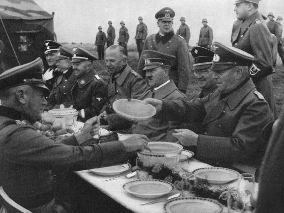 Hitler eating with Nazi officers food tasters